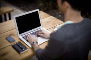 seo-blogging-man-at-laptop-computer